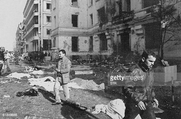 People wander around the scene of a carbomb explosion in front of the central Algiers police headquarters 30 January 1995 At least 35 people were...