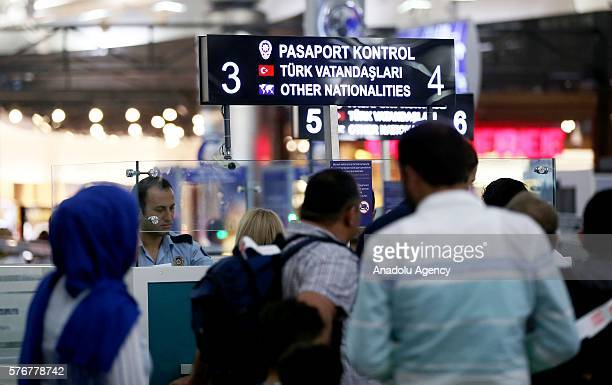 People wanting to go abroad with green passports are checked by Turkish police officers as they stand guard to prevent Parallel State/Gulenist...