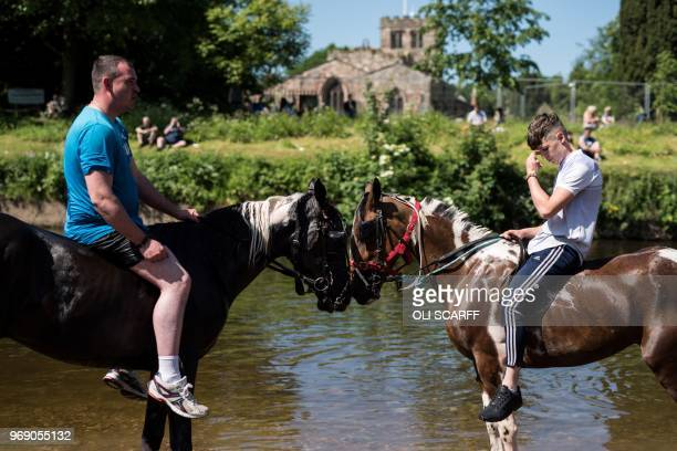 People wash horses in the River Eden on the opening day of the annual Appleby Horse Fair in the town of ApplebyinWestmorland northwest England on...