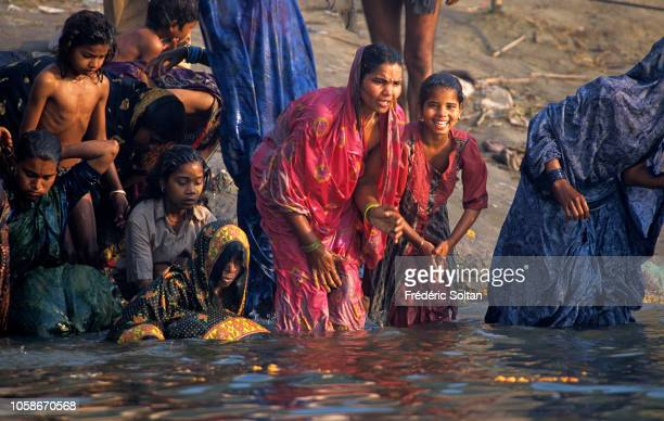 People wash themselves and pray in water of Ganges river in Holy City of Varanasi Religious capital of Hinduism Varanasi is closely associated with...
