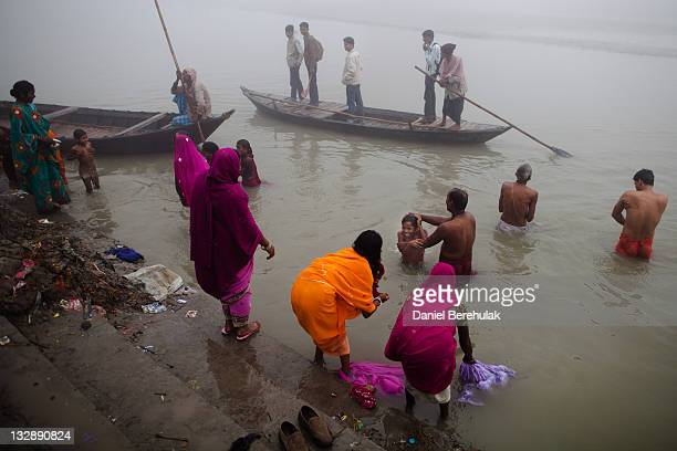 People wash themselves as they take their morning bath in the Ganges river during the Sonepur Mela on November 15 2011 in Sonepur near Patna India...