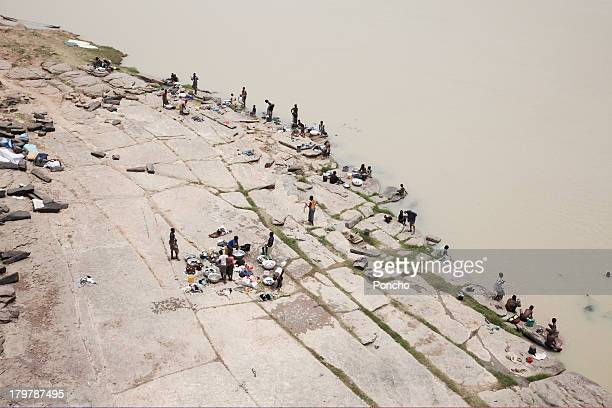 people washing clothes at a river - ghana stock pictures, royalty-free photos & images