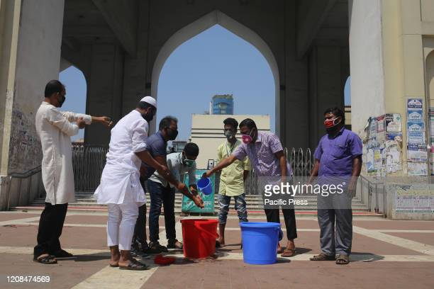 People washing hands with antibacterial soap as a precautionary step to prevent COVID19 before entering the mosque for prayer Total 44 people have...
