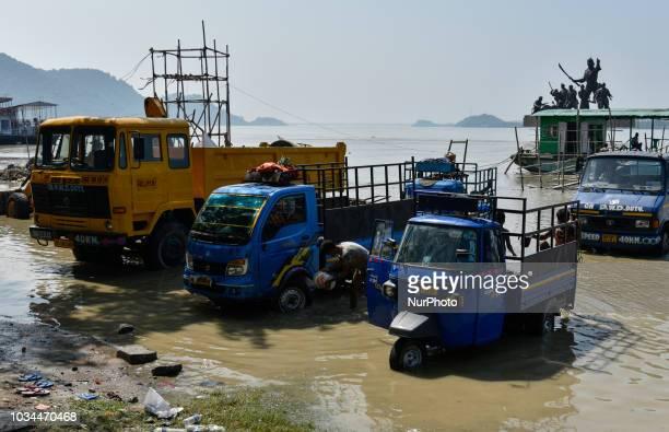 People washing their vehicles in the Brahmaputra river ahead of Vishwakarma puja in Guwahati Assam India on Sunday 16 September 2018 Vishwakarma is...