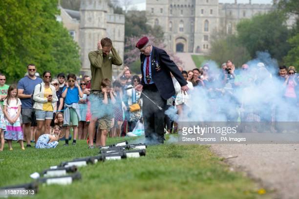 People watch a 21 gun salute to mark Queen Elizabeth II's 93rd birthday on the Long Walk in Windsor Berkshire
