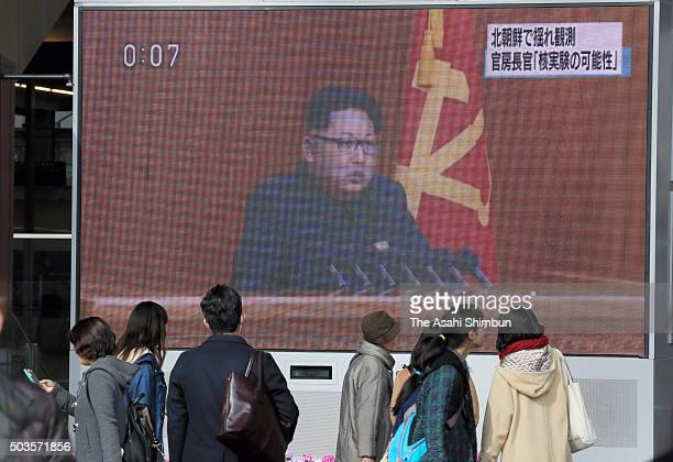 People watch a big screen broadcasting the news of the North Korea's hydrogen bomb test on January 6 2016 in Osaka Japan The Korea Meteorological...
