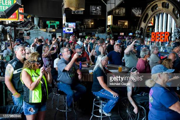 People watch a concert at the Full Throttle Saloon during the 80th Annual Sturgis Motorcycle Rally in Sturgis South Dakota on August 9 2020 While the...