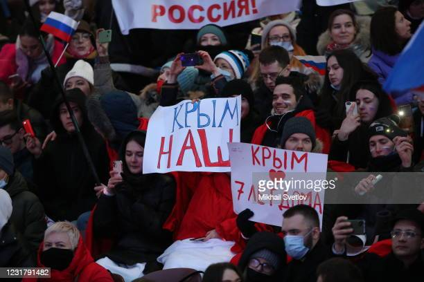 People watch a concert marking the 7th anniversary of Crimea annexation, on March 18, 2021 in Moscow, Russia. Russian President Vladimir Putin...
