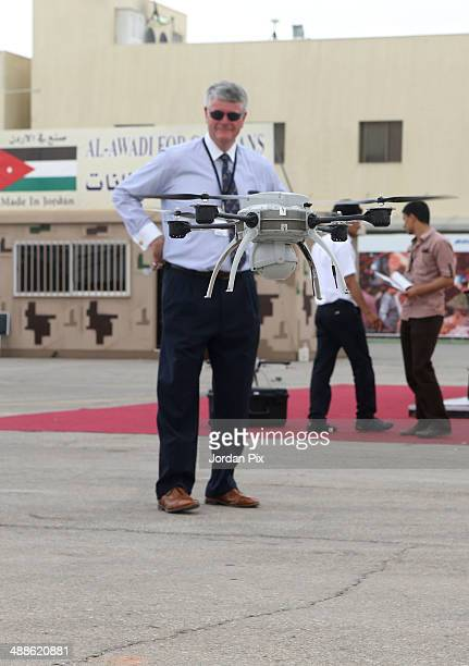 People watch a drone fly at the Special Operation Forces Exhibition on May 07 2014 in Amman Jordan King Abdullah II opened SOFEX that showcases...