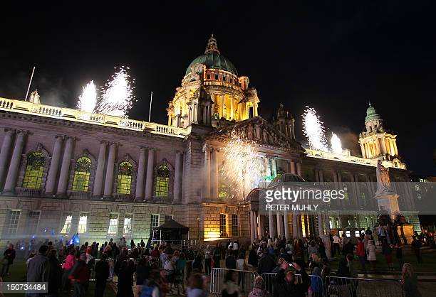 People watch a fireworks display on August 25 2012 after a Paralympic cauldron was lit outside Northern Ireland's parliament in Belfast the second of...