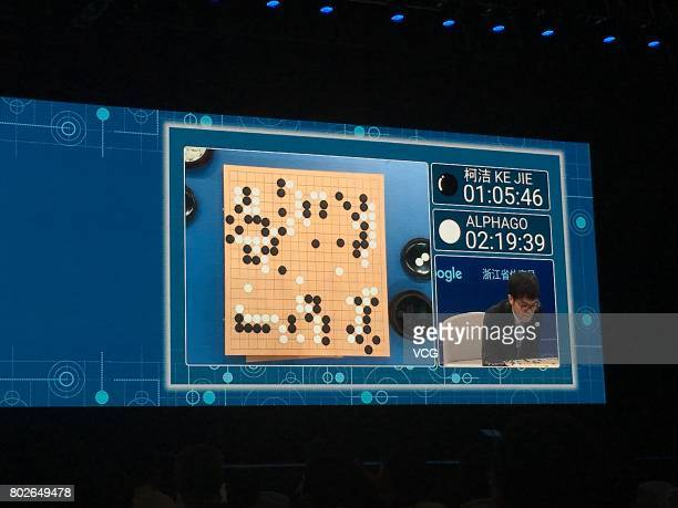 People watch a live broadcast of the game of Go between The World's top human player Ke Jie and Google's artificial intelligence program AlphaGo...