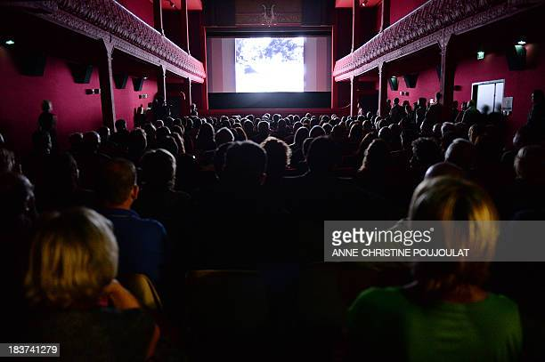 People watch a movie at the world's oldest cinema theater L'Eden during its official reopening on October 9 2013 in La Ciotat southern France AFP...