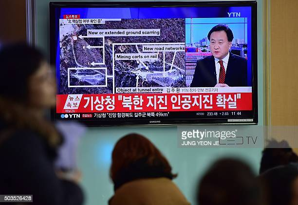 People watch a news report at a railroad station in Seoul on January 6 after seismologists detected a 51 magnitude tremor next to North Korea's main...