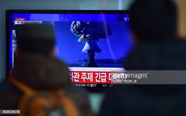 People watch a news report on North Korea's first hydrogen bomb test at a railroad station in Seoul on January 6 2016 South Korea strongly condemned...