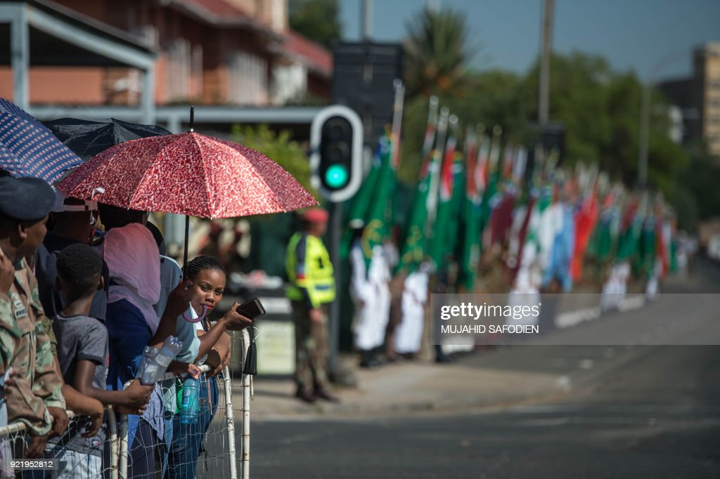 People watch a parade of South African National Defense Force (SANDF) during a day of Armed Forces on February 21, 2018 in Kimberley, South Africa. /