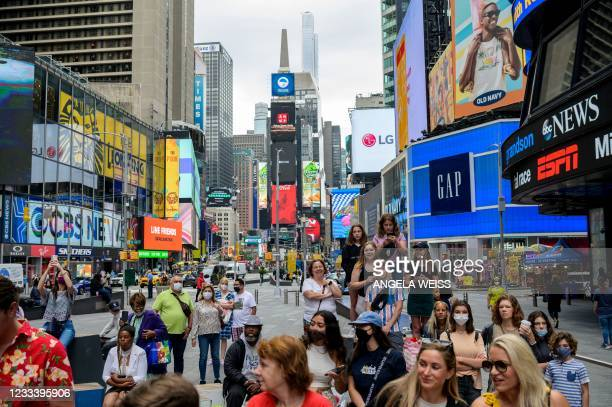 People watch a performance during a pop up event in Times Square on June 11, 2021 in New York City. - Many restrictions aimed at curbing the spread...