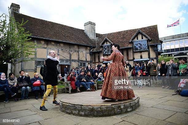 People watch a performance in the grounds of the birthplace of William Shakespeare during events marking 400 years since the bard's death in...
