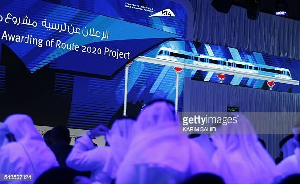 People watch a presentation of the Route 2020 metro expansion project during a press conference on June 29 in the emirate of Dubai Dubai's transport...