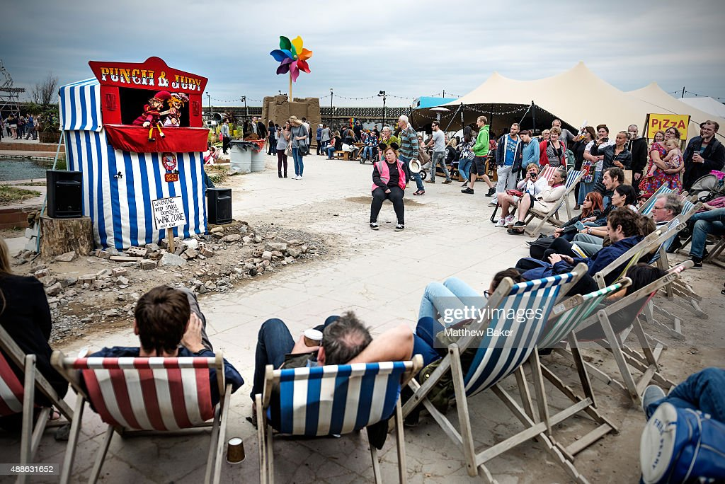 People watch a punch and judy show at Banksy's Dismaland on September 10, 2015 in Weston-Super-Mare, England.