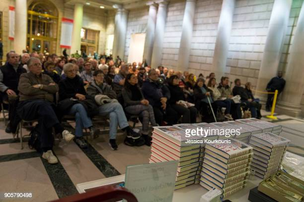 People watch a simulcast discussion of author Michael Wolff talking about his controversial book on the Trump administration titled 'Fire and Fury'...