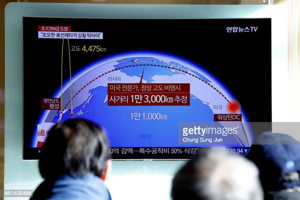 People watch a television broadcast, reporting North Korea's test-launch of its new ICBM, at the Seoul Railway Station on November 29, 2017 in Seoul,...