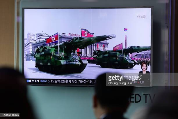 People watch a television broadcast reporting the North Korean missile launch at the Seoul Railway Station on June 8 2017 in Seoul South Korea...