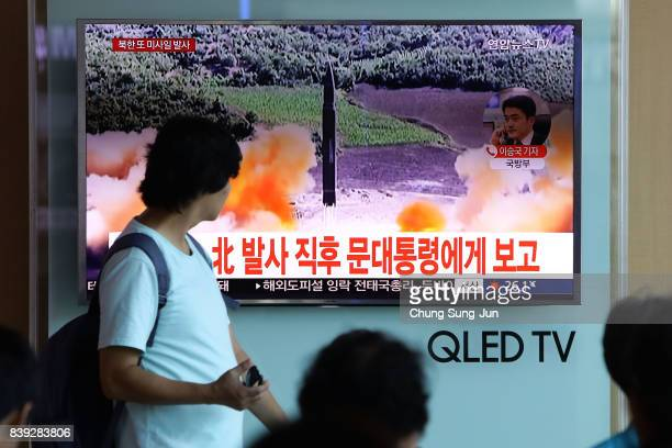 People watch a television broadcast reporting the North Korean missile launch at the Seoul Railway Station on August 26 2017 in Seoul South Korea...