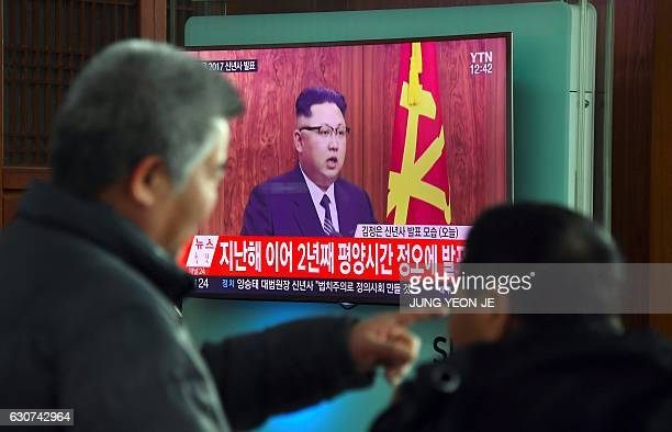 People watch a television news broadcast at a railway station in Seoul on January 1 2017 showing North Korean leader Kim JongUn's New Year's speech...