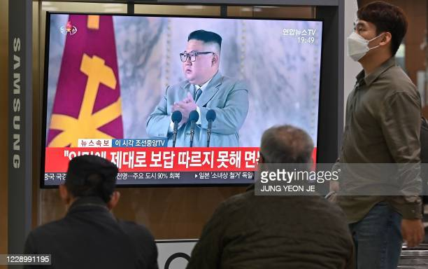 People watch a television news broadcast of a speech by North Korea's leader Kim Jong Un during commemorations of the 75th anniversary of the North's...