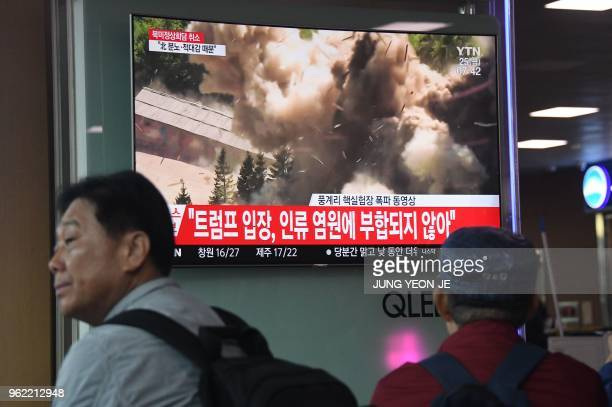 People watch a television news presentaion at a railway station in Seoul on May 25, 2018 showing the dismantling of North Korea's Punggye-ri nuclear...