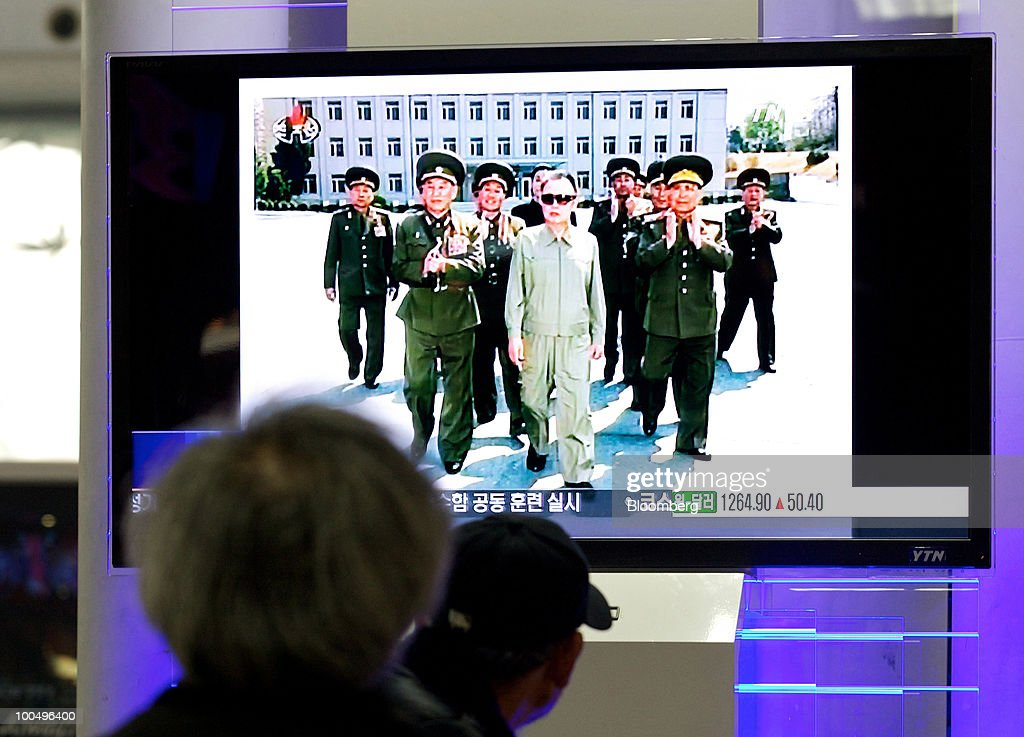 People watch a television program showing North Korean leader Kim Jong Il, at Seoul Station in Seoul, South Korea, on Tuesday, May 25, 2010. Asian stocks and the won plunged to 10-month lows after a report that Kim ordered his military to prepare for combat last week. Photographer: SeongJoon Cho/Bloomberg via Getty Images