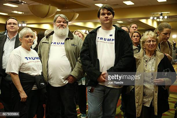 People watch a television showing the Caucus return numbers at the Donald Trump for President Caucus Watch Party at the Sheraton Hotel on February 1...