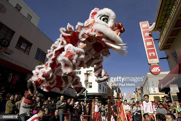 People watch a traditional lion dance in front of a bank on the first day of Chinese New Year on January 29 2006 in Chinatown San Francisco...