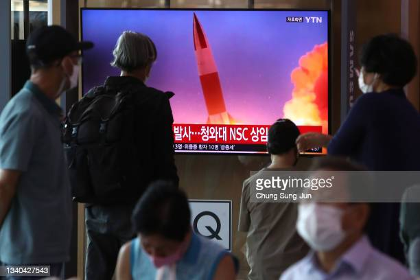 People watch a TV at the Seoul Railway Station showing a file image of a North Korean missile launch, on September 15, 2021 in Seoul, South Korea....