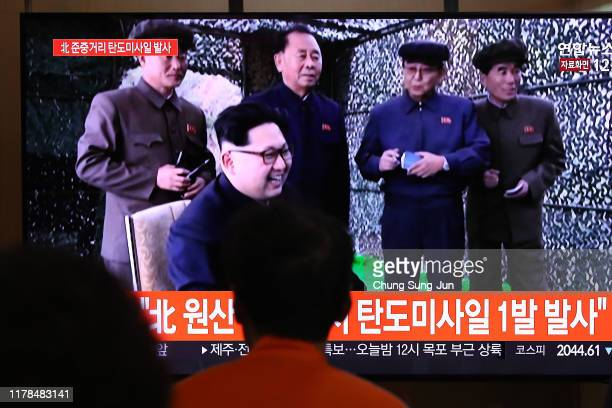 People watch a TV showing a file image of a North Korean missile launch at the Seoul Railway Station on October 02, 2019 in Seoul, South Korea. North...