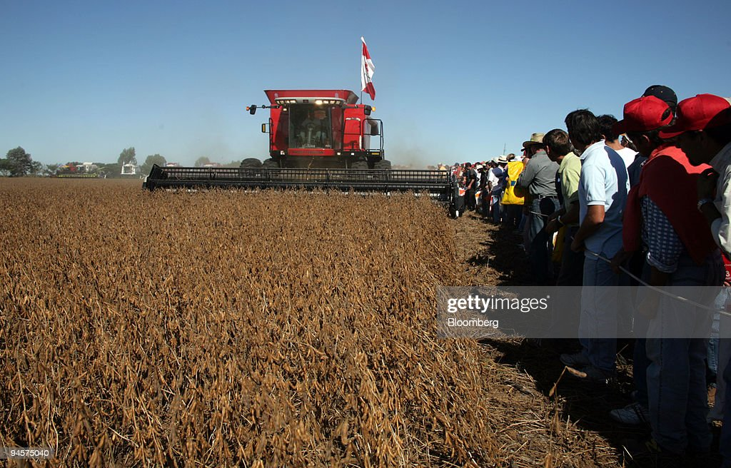 People watch a US made Massey Ferguson swather series MF 900 ...