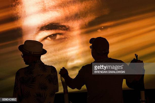 TOPSHOT People watch a video at the Muhammad Ali Center June 9 2016 in Louisville Kentucky Two days of funeral ceremonies bidding farewell to...