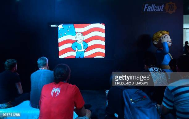 People watch a video on 'Fallout 76' at the 24th Electronic Expo or E3 2018 in Los Angeles California on June 13 where hardware manufacturers...