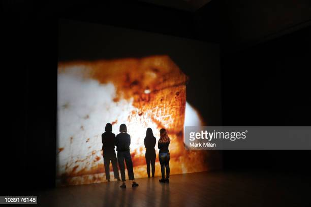 People watch a video piece by artist Luke Willis Thompson during the Turner Prize 2018 Photocall held at Tate Britian on September 24 2018 in London...