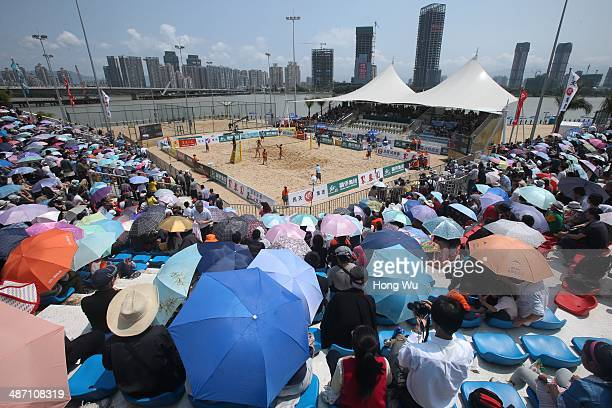 People watch a women's semifinal match on Day 6 of the 2014 FIVB Beach Volleyball Fuzhou Open on April 27 2014 in Fuzhou China