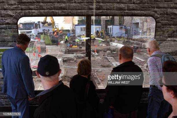 People watch activity on a work site in Melbourne's central business district on September 5 2018 Australia's buoyant economy powered ahead in the...