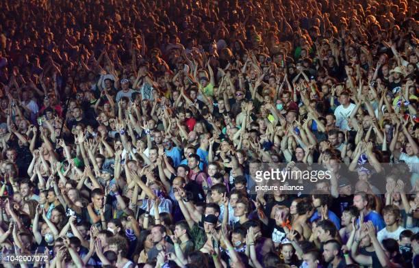 People watch American band Ugly Kid Joe at Przystanek Woodstock in Kostrzyn Poland 01 August 2013 The festival's motto is 'Love Friendship and Music'...