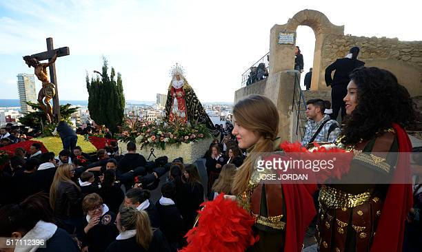 People watch an effigy of Jesus Christ on the cross is carried down steps during the Cristo de la Fe populary known as the gypsy Christ parade during...