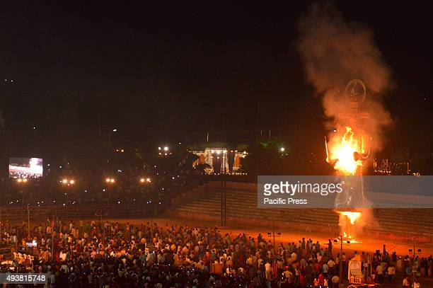 People watch an effigy of the tenheaded demon king Ravana go up in flames during Dussehra celebrations effigy of demon king Ravana is as part of...