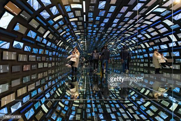 People watch an exhibition at 'AHSPACE' immersive live broadcast base on January 23, 2021 in Hefei, Anhui Province of China.