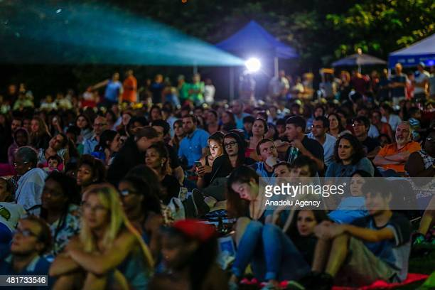 People watch an outdoor screening of the film 'Attack the Block' at Brooklyn Bridge Park on July 23 2015 in New York City New York