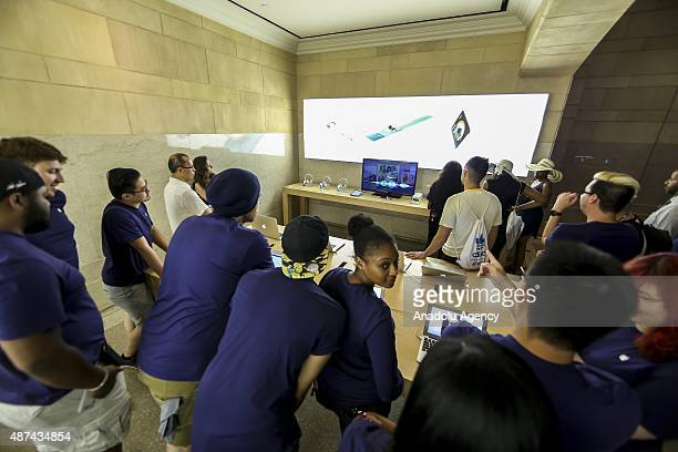 People watch Apple's announcement of new versions of old products at a Apple Store in New York NY on September 9 2015 Apple Inc unveils iPhone 6S...