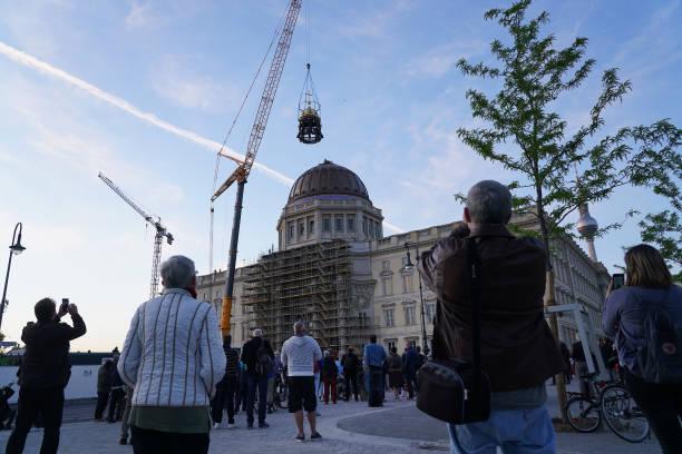 DEU: Berlin City Palace Receives Its Golden Cupola And Cross