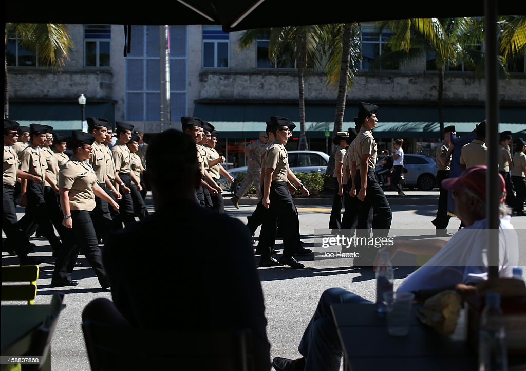 People Watch As A JROTC Honor Guard Team Marches Past Spectators During The Miami Beach Veterans
