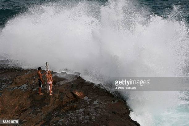 People watch as a wave crashes against the rocks at the Halona Blowhole October 22 2008 in Honolulu Hawaii Democratic presidential candidate Barack...